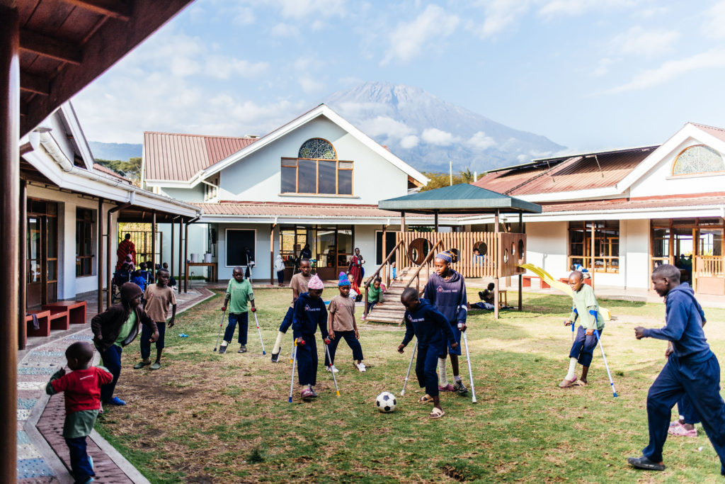 Kids kick soccer ball in Tanzania while recovering from surgery