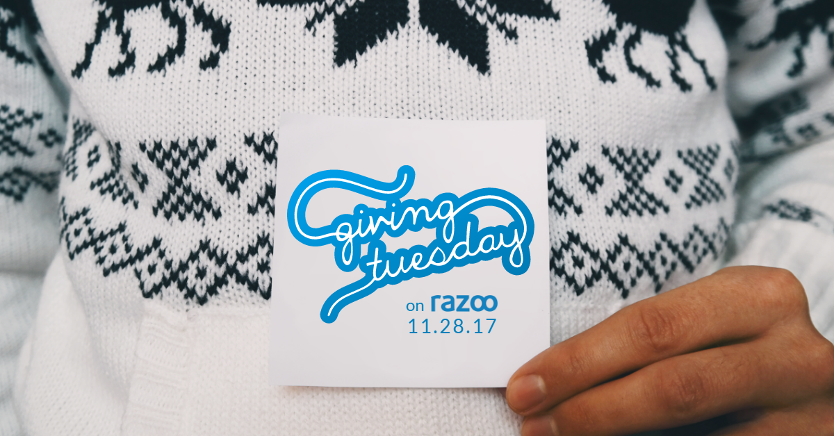 Hand holding card with #GivingTuesday logo and date on it