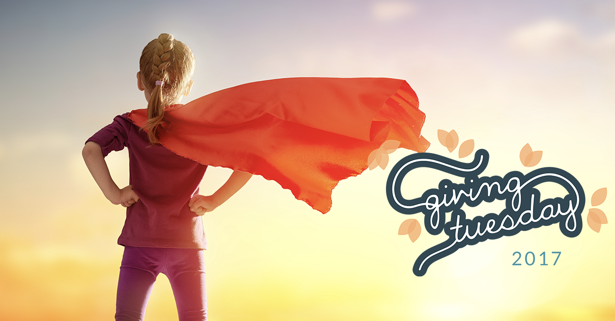 Child standing in front of sunset with cape and #GivingTuesday logo