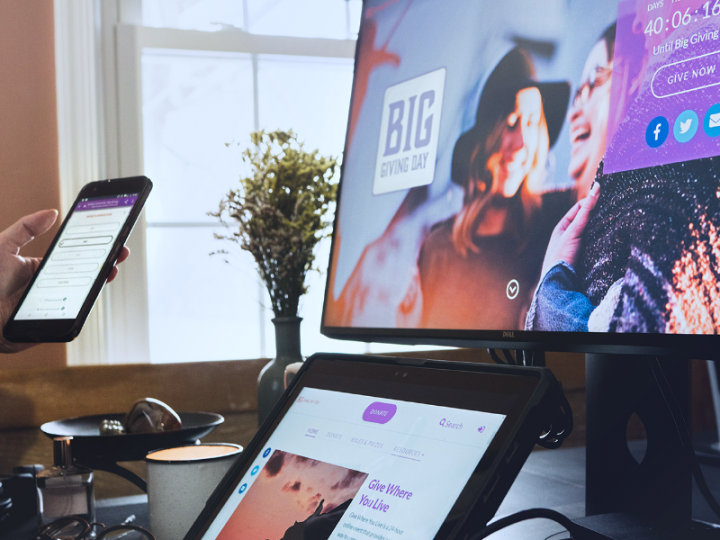 photo of someone using the Mightycause giving day platform on a desktop computer tablet and mobile phone