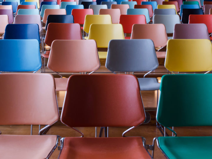 spring fundraiser - Rows of colorful chairs in Auditorium