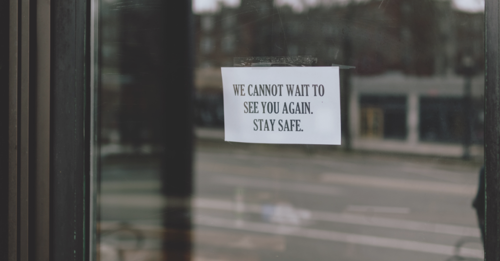 """note on a door that says """"we cannot wait to see you again, stay safe"""""""