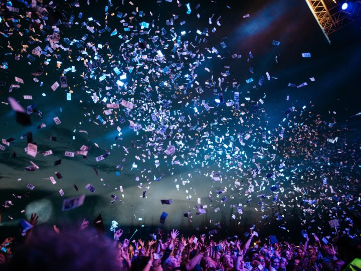 participating in a giving event: photo of crowd with confetti falling from ceiling