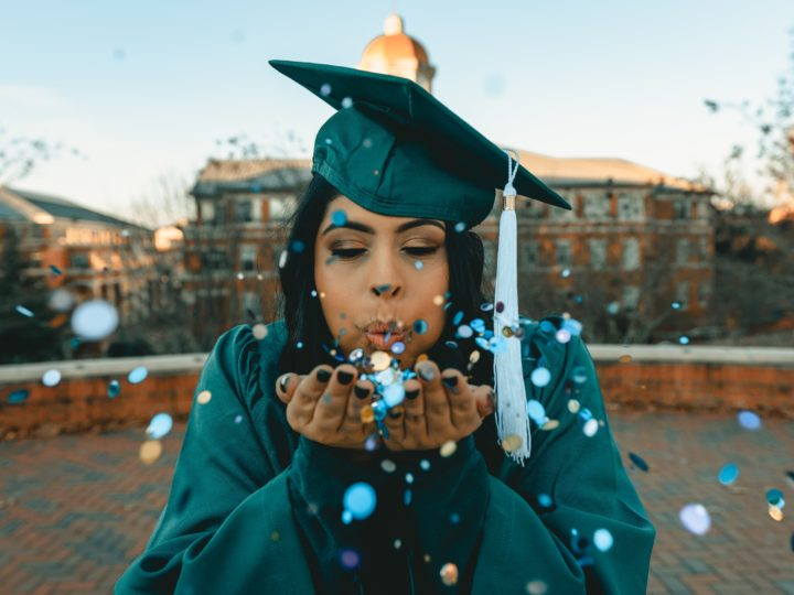 university giving days: graduate in cap & gown