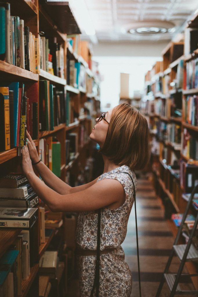 fundraising resources: image of women with glasses looking at library books on a shelf