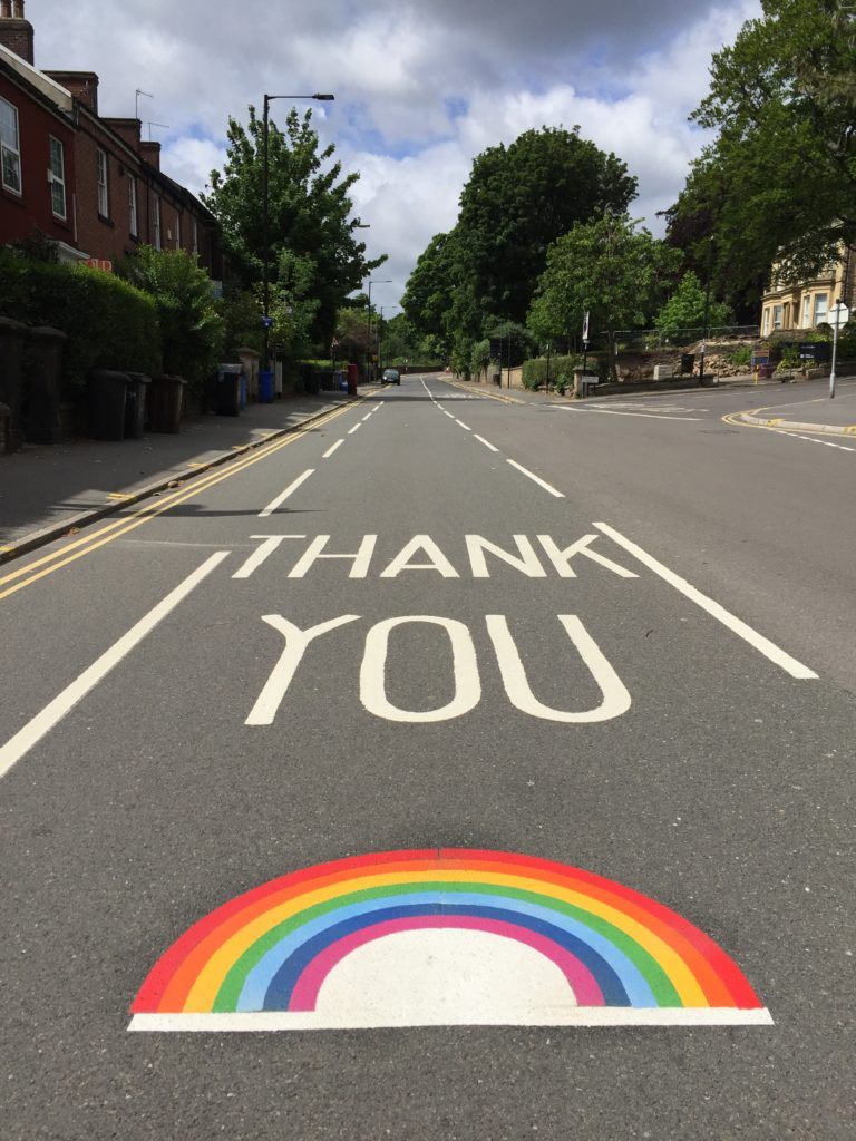 thank you written on a road