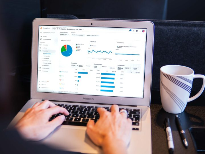 google analytics: person with analytics on their macbook air