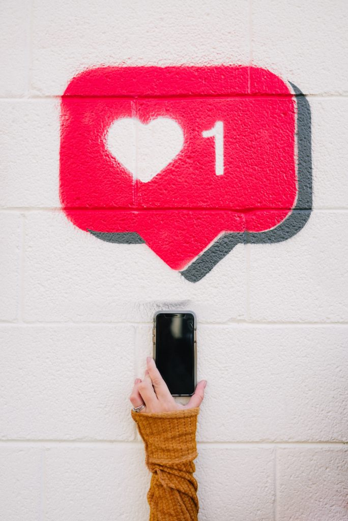 facebook like icon spraypainted on white wall