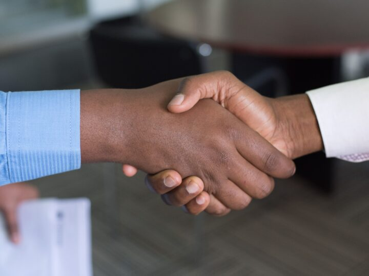 how to secure a matching grant: featured image with two people shaking hands