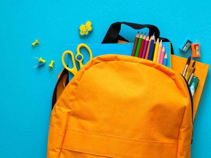 pta fundraiser: Back to school concept. Backpack with school supplies. Top view. Copy space